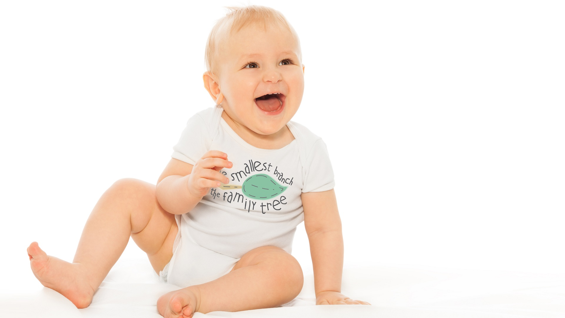 A laughing baby wearing an Itty Bitty Branch onesie